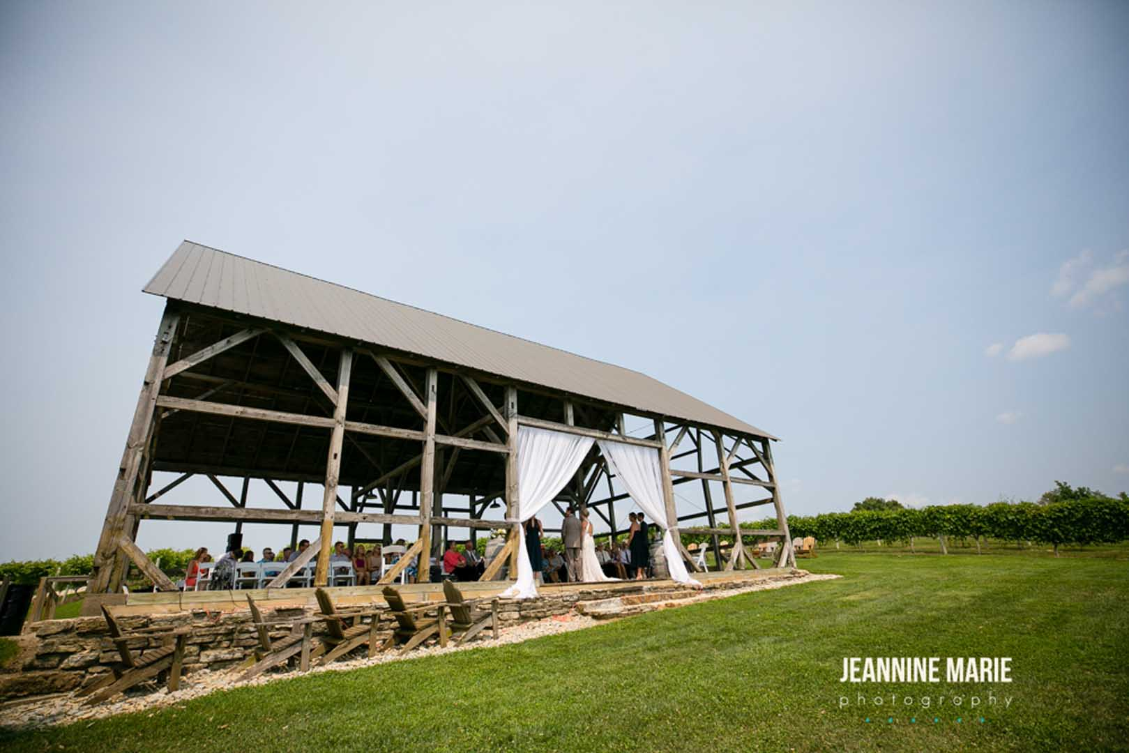 Timber barn wedding venue surrounded by grape vines